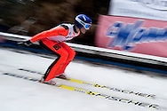 Mikhail Maksimochkin from Russia competes while training session during FIS World Cup Ski Jumping competition in Zakopane, Poland on January 17, 2014.<br /> <br /> Poland, Zakopane, January 17, 2014.<br /> <br /> Picture also available in RAW (NEF) or TIFF format on special request.<br /> <br /> For editorial use only. Any commercial or promotional use requires permission.<br /> <br /> Mandatory credit:<br /> Photo by © Adam Nurkiewicz / Mediasport