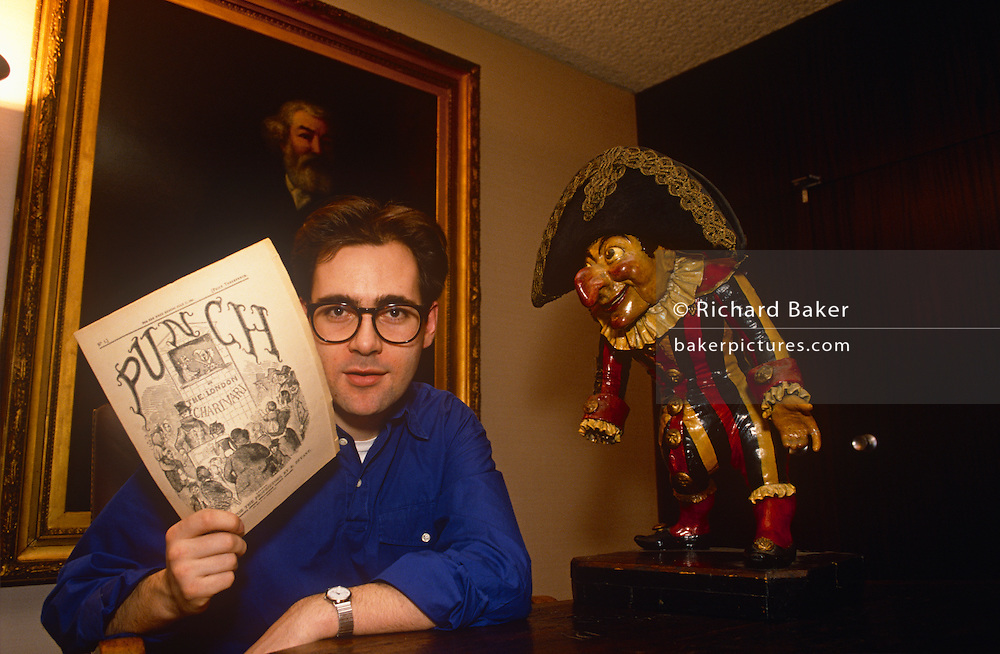 A formal portrait of English journalist David Thomas, after his appointment as the new editor of Punch Magazine, in February 1989, London England. Thomas was Young Journalist of the Year at the age of 24, became a magazine editor at 25 and was the youngest editor in the 150-year history of Punch magazine at 29. Since 1992 he has worked as a freelance author and journalist. He now writes fiction under his own name and as Tom Cain and, as of February 2015, David Churchill.