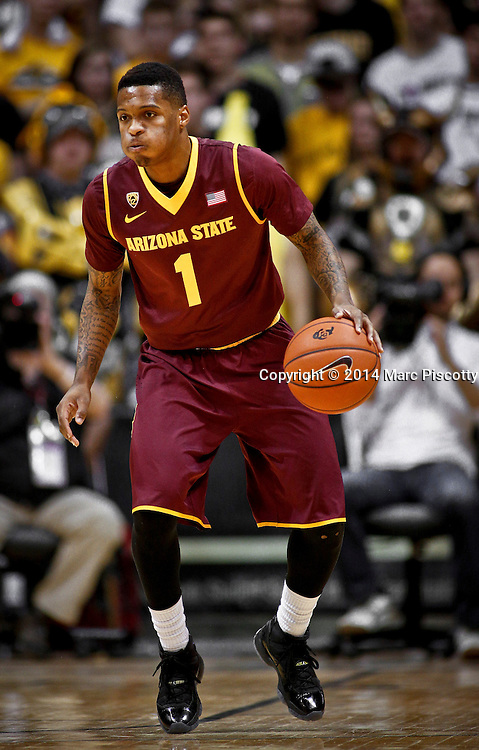 SHOT 2/19/14 10:23:48 PM - Arizona State's Jahii Carson #1 dribbles the ball during their regular season Pac-12 basketball game against Colorado at the Coors Events Center in Boulder, Co. Colorado won the game 61-52.<br /> (Photo by Marc Piscotty / &copy; 2014)
