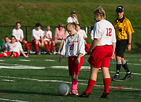 Sonja Frost looks for her shot with Lexi Bladecki during Laconia's Unified Soccer match with Winnisquam on Monday afternoon.  (Karen Bobotas/for the Laconia Daily Sun)