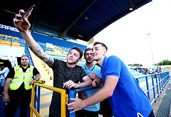 Tom Lockyer of Bristol Rovers poses for selfies with fans - Mandatory by-line: Robbie Stephenson/JMP - 18/07/2017 - FOOTBALL - Estadio da Nora - Albufeira,  - Hull City v Bristol Rovers - Pre-season friendly
