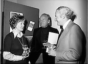 25/07/1977<br /> 07/25/1977<br /> 25 July 1977<br /> ROSC '77 Press Reception at Peter Owens Ltd. <br /> Dr. Marie dePaor, archaeologist; Dr. Michael Scott, Chairman ROSC '77 committee and Mr William O'Loghlen, Director of the Bank of Ireland, one of the sponsors of ROSC '77, photographed at the press reception to announce the details of the forthcoming exhibition in Dublin.