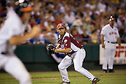 OMAHA, NE - JUNE 17:   Mike Bolsinger of the Arkansas Razorbacks prepares to throw out a runner at first base during a game against the Virginia Cavaliers at the College World Series on June 17, 2009 at Rosenblatt Stadium in Omaha, Nebraska.  Arkansas defeated Virginia 4 - 3 in 12 innings.  (Photo by Wesley Hitt/Getty Images) *** Local Caption *** Mike Bolsinger