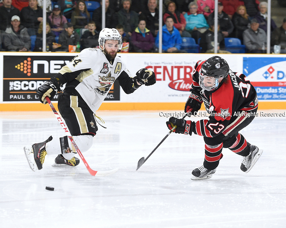 TRENTON, ON - APR 23,  2017: Ontario Junior Hockey League, Championship Series. Georgetown Raiders vs the Trenton Golden Hawks in Game 6 of the Buckland Cup Final.  Nick Boddy #44 of the Trenton Golden Hawks tries to keep the puck from Jack Jacome #23 of the Georgetown Raiders during the second period.<br /> (Photo by Andy Corneau / OJHL Images)