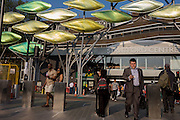 Commuters beneath the new kinetic sculpture at Stratford Centre 'The Shoal' at the Stratford Centre, east London, is made up of around 100 titanium clad 'leaves' mounted between 15 and 19 metres high on metal posts. Worth £13.5m, the Shoal is part of The Stratford Town Centre Public Realm Project, designed and manufacturered using 3D technology.