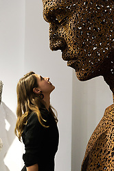 © Licensed to London News Pictures. 13/09/2018. London, UK. Visitor views a bicycle chain sculpture titled Iron chain (Rust) 2013 by artist SEO Young-Deok.  His work is part of a joint exhibiton with British artist Nick Gentry at the Opera Gallery. Photo credit: Ray Tang/LNP