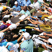Rory McIlroy is besieged by autograph hunters at the end of his ProAm round during The Barclays Golf Tournament at The Ridgewood Country Club, Paramus, New Jersey, USA. USA. 20th August 2014. Photo Tim Clayton