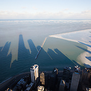 Chicago, view over Lake Michigan from the Sears Tower with the long shadows cast by the downtown skyscraper in the afternoon light.