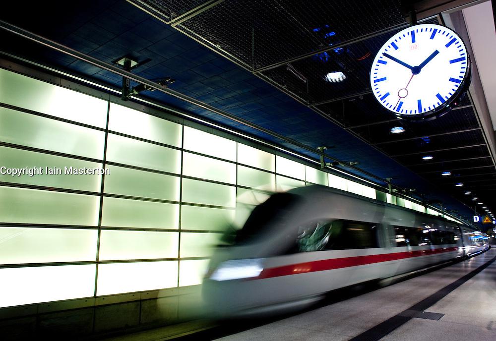 German ICE Express train travelling through Potsdamer Platz railway station Berlin 2009