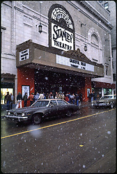 Snow and Deadheads Outside the Stanley Theater in Pittsburgh PA. Before the Grateful Dead Concert on March 5, 1981. Full Slide Scan. Other images in gallery are slices of this image. Image No. 1981-C11-01