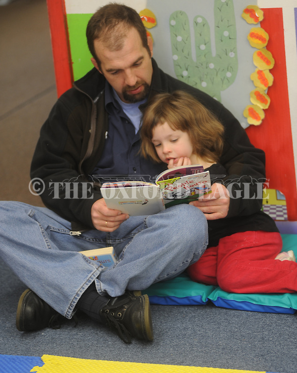 Fathers read to their children as Oxford-University School celebrated Dr. Seuss birthday on Friday, March 5, 2010.