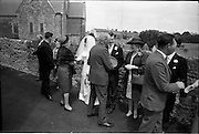 05/07/1967<br /> 07/05/1967<br /> 05 July 1967<br /> Wedding of George Walsh, eldest son of Mr and Ms Kevin G. Walsh, St. Rita's, Firhouse Road, Templeogue, Co. Dublin and Miss Arlene McMahon, elder daughter of Det. Chief Supt. Philip McMahon, Head of Special Branch, Dublin Castle and Mrs McMahon of Lisieux, Templeville Park, Templeogue, Co. Dublin who were married at the Carmelite Church, Terenure College, Dublin. An Taoiseach Mr Jack Lynch and Mrs Lynch; Mr Liam Cosgrave, leader Fine Gael and Mrs Cosgrave were among the 120 guests. Rev Fr H.E. Wright, O. Carm., Moate, officiated at the ceremony. The reception was held at Downshire Hotel, Blessington, Co. Wicklow. Bride and Groom being congratulated outside the church.
