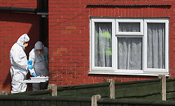 Police forensic investigators at an address in Elsmore Road, Greater Manchester, after a suicide bomber killed 22 people, including children, as an explosion tore through fans leaving a pop concert in Manchester.