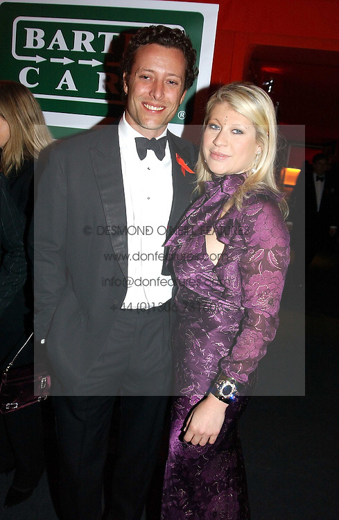 """GIULIA CONSTANTINI and TOBY ROWLANDS at the 10th annual British Red Cross London Ball.  This years ball theme was Indian based - """"Yaksha - Yakshi: Doorkeepers to the Divine"""" and was held at The Room, Upper Ground, London on 1st December 2004.  Proceeds from the ball will aid vital humanitarian work, including HIV/AIDS projects that the Red Cross supports in the UK and overseas.<br /><br />NON EXCLUSIVE - WORLD RIGHTS"""