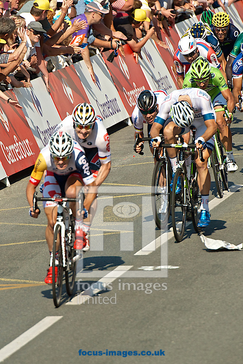 Picture by Ian Wadkins/Focus Images Ltd +44 7877 568959<br /> 09/07/2013<br /> Mark Cavendish (left) collides with Tom Veelers during stage 10 of the 2013 Tour de France in Saint Malo, France.