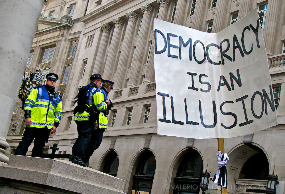 Police photographers record videos and stills of people demonstrating in the streets. G20 London Summit Meltdown. Demonstration at the Bank of England on 1st of April 2009.