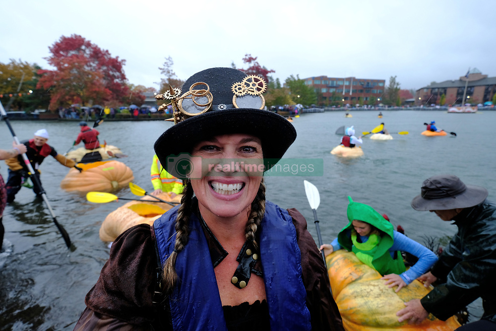 Champion pumpkin racer Charity Marshall is pictured at the 14th annual West Coast Giant Pumpkin Regatta in Tualatin, Ore. on October 21, 2017. (Photo by Alex Milan Tracy)