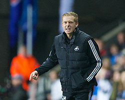 SWANSEA, WALES - Thursday, February 20, 2014: Swansea City's manager Gary Monk against SSC Napoli during the UEFA Europa League Round of 32 1st Leg match at the Liberty Stadium. (Pic by David Rawcliffe/Propaganda)