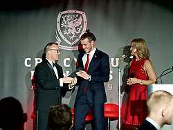CARDIFF, WALES - Thursday, March 21, 2019: Wales' Gareth Bale receives his Players' Player of the Year award from sponsor Brains during the Football Association of Wales Awards 2019 at the Hensol Castle. (Pic by Ian Cook/Propaganda)