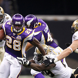 September 9, 2010; New Orleans, LA, USA;  Minnesota Vikings running back Adrian Peterson (28) breaks the tackle by New Orleans Saints defensive lineman Anthony Hargrove (69) during first half of the NFL Kickoff season opener at the Louisiana Superdome. Mandatory Credit: Derick E. Hingle