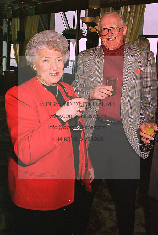 MR & MRS BILL TIDY, he is the cartoonist, at a luncheon in London on 31st January 1999.MNR 28