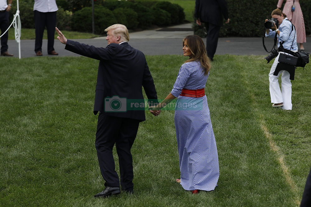 July 4, 2018 - Washington, District of Columbia, United States of America - U.S. President Donald Trump and First Lady Melania Trump leave after attending a picnic for military families in Washington, D.C., U.S., on Wednesday, July 4, 2018. Dozens of retired military and national security officers joined the NAACP and the American Medical Association in urging a federal appeals court to uphold a court order blocking Trump's ban on transgender people serving in the military. .Credit: Yuri Gripas / Pool via CNP (Credit Image: © Yuri Gripas/CNP via ZUMA Wire)