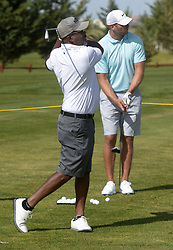 July 2, 2018 - U.S. - SPORTS -- Country singer Darius Rucker, left, and Pro Football Hall of Famer and former UNM Star Brian Urlacher hit balls on the driving range at the Santa Ana Golf Course during the New Mexico Grande Slam, a golf charity event that raises money for New Mexico's children, on Monday, July 2, 2018. (Credit Image: © Greg Sorber/Albuquerque Journal via ZUMA Wire)
