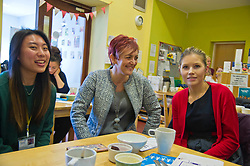 Pictured: Angela Constance, Communities Secretary had the opportunity to chat with Digital Drop In volunteer Students, Orla Landy (red cardigan) and Nicole Nq (green top)<br /> Today Communities Secretary  Angela Constance visited Dr Bells family centre, where she met staff and volunteers ahead of the first Tackling Child Poverty Delivery Plan being published.<br /> <br /> <br /> Ger Harley | EEm 29 March 2018