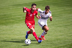 WREXHAM, WALES - Thursday, August 15, 2019: Cyprus'  Marios Fasouliotis and Malta's captain Kian Leonardi during the UEFA Under-15's Development Tournament match between Cyprus and Malta at Colliers Park. (Pic by Paul Greenwood/Propaganda)