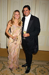 MISS KATE SHAND and MR EDWARD TAYLOR at a dinner hosed by Moet & Chandon at their headquarters at 13 Grosvenor Crescent, London on 12th October 2005.<br />