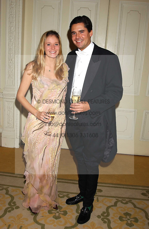 MISS KATE SHAND and MR EDWARD TAYLOR at a dinner hosed by Moet &amp; Chandon at their headquarters at 13 Grosvenor Crescent, London on 12th October 2005.<br />