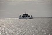 Nederland, Holwerd, Ameland, 21-8-2010Vanaf de veerboot de Sier hebben passagiers mooi zicht op de zonsondergang en de lage waddenzee. Het zusterschip de Oerd wordt gepasseerd.Foto: Flip Franssen/Hollandse Hoogte