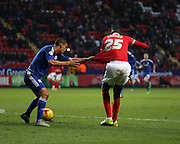 Charlton Athletic striker, Yaya Sanogo (25) getting his shirt pulled in the box during the Sky Bet Championship match between Charlton Athletic and Cardiff City at The Valley, London, England on 13 February 2016. Photo by Matthew Redman.