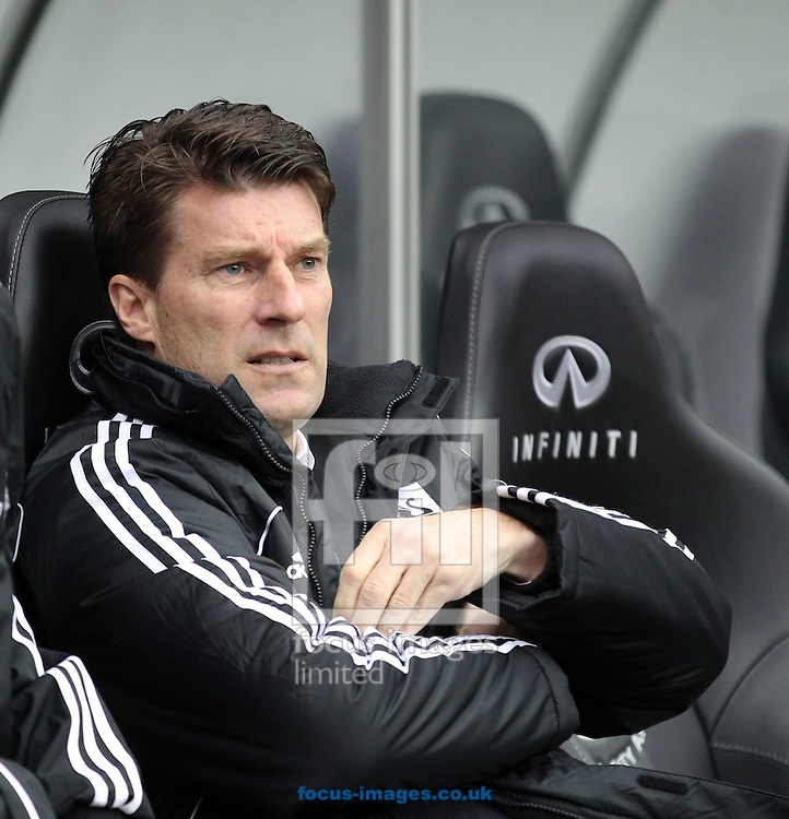 Picture by Mike  Griffiths/Focus Images Ltd +44 7766 223933.16/03/2013.Michael Laudrup, Manager of Swansea City against Arsenal during the Barclays Premier League match at the Liberty Stadium, Swansea.