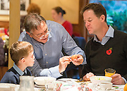 © Licensed to London News Pictures. 03/11/2014. Oxford, UK. RAYMOND BLANC (C) shows NICK CLEGG (R) and local schoolboy Hugo Stone how to spot if it is safe to use a raw egg in cooking.  To celebrate National School Meals Week (3-7 November), the Deputy Prime Minister, Nick Clegg, joins school children at Brasserie Blanc in Oxford to get some top cooking tips from Raymond Blanc. The visit is part of a larger national effort to raise awareness of and enhance children's relationship with food. The Deputy Prime Minister has called on celebrity chefs to lead the way by joining forces with school cooks to promote the great school lunch. School cooks up and down the country will be taking their skills out of the school kitchen to showcase to parents and pupils the variety and quality of food now being served in schools. National School Meals Week comes just months after the launch of free school meals for 2.8 million primary school children and the introduction of cooking in the curriculum.. Photo credit : Stephen Simpson/LNP