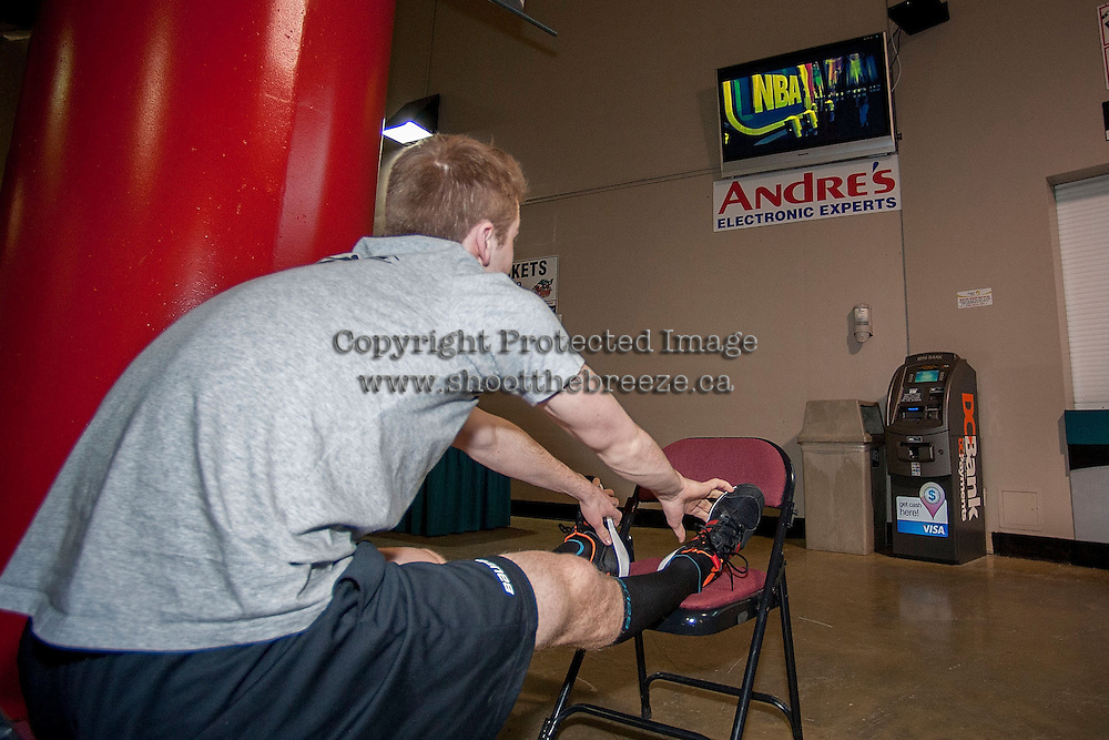 KELOWNA, CANADA -FEBRUARY 25: Rourke Chartier #14 of the Kelowna Rockets does some pre-game stretches while watching Rogers Sportsnet on February 25, 2014 at Prospera Place in Kelowna, British Columbia, Canada.   (Photo by Marissa Baecker/Getty Images)  *** Local Caption *** Rourke Chartier;