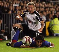 Fotball<br /> England<br /> Foto: Fotosports/Digitalsport<br /> NORWAY ONLY<br /> <br /> Fulham FC vs FC Basel UEFA Europa League 01/10/09<br /> <br /> Fulham's Bjørn Helge Riise tangles with Marcos Gelabert