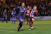 Tranmere Rovers Jake Caprice (14) & Lincoln City's Ellis Chapman (12) during the EFL Sky Bet League 1 match between Lincoln City and Tranmere Rovers at Sincil Bank, Lincoln, United Kingdom on 14 December 2019.