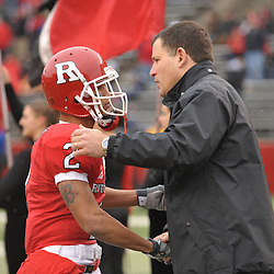 Dec 5, 2009; Piscataway, NJ, USA; Rutgers head coach Greg Schiano shakes hands with wide receiver Tim Brown during the senior ceremony before first half NCAA Big East college football action between Rutgers and West Virginia at Rutgers Stadium.