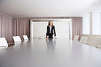Female Business Executive standing in Boardroom