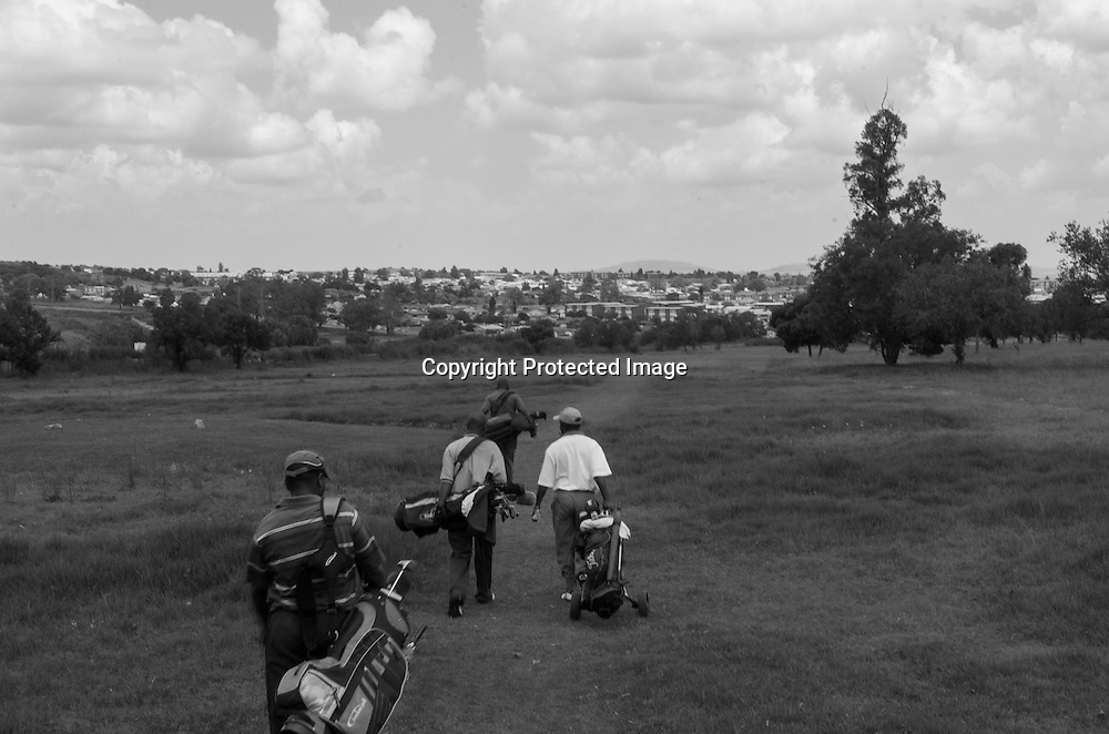 Golfers make their way around the track at the Soweto Country Club, the home club for a number of the Sunshine Tour's black professionals.
