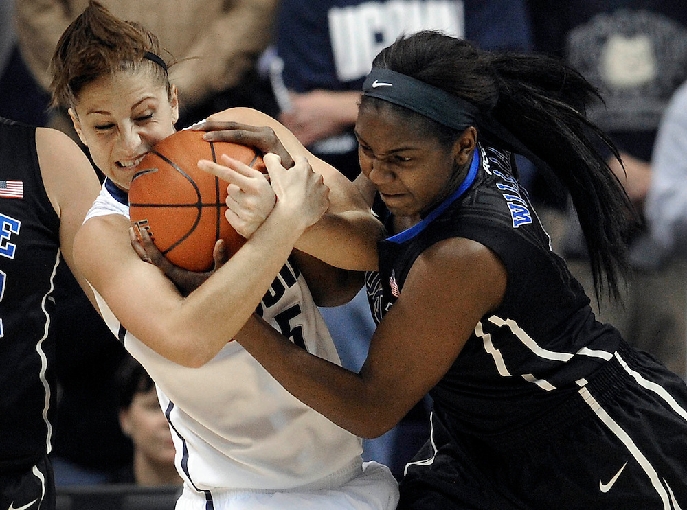 Connecticut's Caroline Doty and Duke's Elizabeth Williams, right, scrap for the ball during the first half of an NCAA college basketball game in Storrs, Conn., Monday, Jan. 21, 2013. (AP Photo/Jessica Hill)