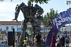 July 29, 2017 - Ankara, Turkey - People are seen in front of a Transformers robot on the opening day of the 7th International Big Ankara Festival in Ankara, Turkey on July 29, 2017. The festival will continue between between July 29 and August 06, which is held by the metropolitan municipality for the first time after three years. (Credit Image: © Altan Gocher/NurPhoto via ZUMA Press)