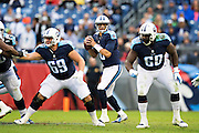 NASHVILLE, TN - NOVEMBER 29:  Marcus Mariota #8 drops back to pass behind Andy Gallik #69 and Quinton Spain #60 of the Tennessee Titans during a game against the Oakland Raiders at Nissan Stadium on November 29, 2015 in Nashville, Tennessee.  The Raiders defeated the Titans 24-21.  (Photo by Wesley Hitt/Getty Images) *** Local Caption *** Marcus Mariota; Andy Gallik; Quinton Spain