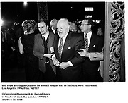 Bob Hope arriving at Chasens for Ronald Reagan's 85 th birthday. West Hollywood. Los Angeles. 1996. Film. 9627/17<br />