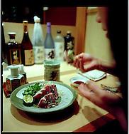 Katsuo (bonito) sashimi at a Tokyo sushi restaurant, Ichigaya, Tokyo, Japan.