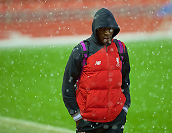 LIVERPOOL, ENGLAND - Saturday, January 30, 2016: Liverpool's Christian Benteke arrives in a hale storm before the FA Cup 4th Round match against West Ham United at Anfield. (Pic by David Rawcliffe/Propaganda)