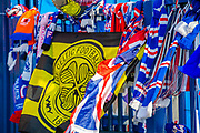 A Celtic flag amongst the Rangers scarves at the impromptu memorial at the gates of Ibrox Stadium, Glasgow, Scotland to Fernando Ricksen, the former Rangers player, who sadly passed away the day before the Europa League match between Rangers FC and Feyenoord Rotterdam on 19 September 2019.