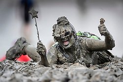 © Licensed to London News Pictures. 12/05/2019. Maldon, UK. A competitor dressed as Tinkerbell takes part in the Maldon Mud Race in Essex. The race originated in 1973 and involves competitors racing around a course on the mudbanks of the river Blackwater at low tide. Photo credit: Peter Macdiarmid/LNP