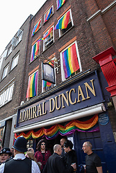 London, UK. 30th April 2019. Members of the LGBTQ community begin to gather to join survivors of the Admiral Duncan bombing and families and friends of the victims outside the Admiral Duncan pub in Old Compton Street, Soho, to mark 20 years since the attack. Three people were killed and 79 injured when a bomb packed with up to 1,500 four-inch nails was detonated by a neo-Nazi at the Admiral Duncan on 30th April 1999.